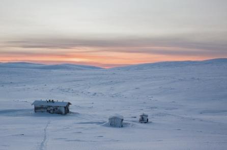 Kuonjarjoki wilderness hut seen from the nearby hill.